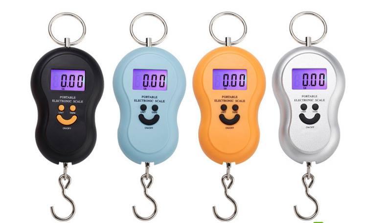 Cân điện tử mini cầm tay có thể cân tối đa 40kg và tối thiểu 10g