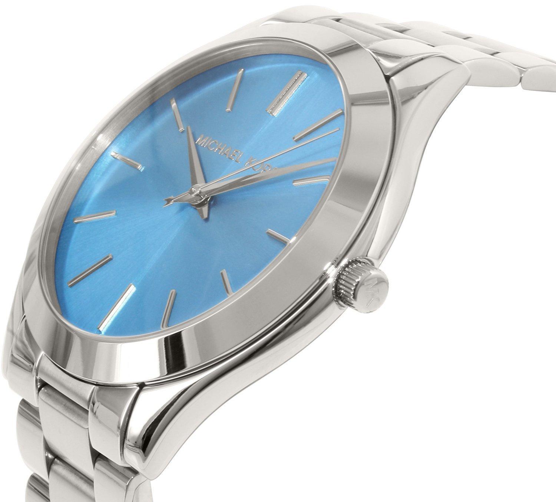 Mặt số dial trắng kết hợp với kim chỉ giờ số la mã, to bản mang phong cách vintage ấn tượng. Mặt kính khoáng bền, chống va đập, chống xước hiệu quả
